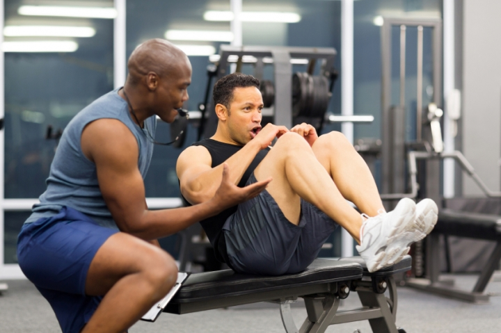 middle-aged-man-with-personal-trainer